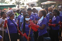 Some female staff of Jospong group cheerfully cleaning up the market