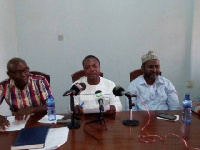 Charles Nyaaba (middle) reading the statement