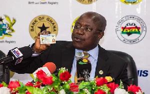 NIA Boss, Professor Ken Attafuah holding a Ghana Card