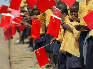 African children holding the flags of China