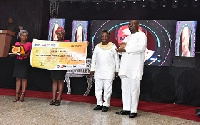 NIB management with the GHC50,000 cheque donation at Annual MUSIGA Presidential Grand Ball