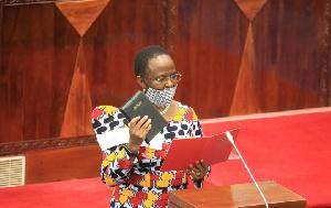 Liberata Mulamula taking her oath as a Member of Parliament