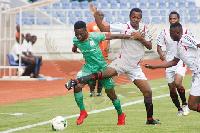 Zikiru Adams is being battled for the ball