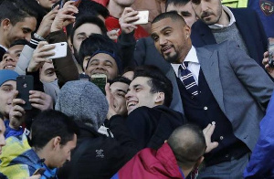 Kevin-Prince Boateng joins some fans for a selfie