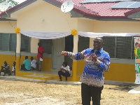 Mr. Emmanuel Armah-Kofi Buah delivering a speech infront of the new health facility