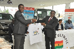 GOC President, Ben Nunoo Mensah presenting a shirt to a rep of Toyota Ghana