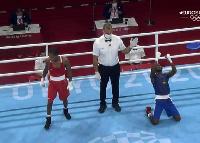 Sulemanu Tetteh [blue] celebrates his victory