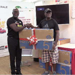 A customer receiving his prize at the