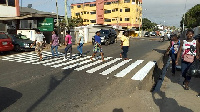 The team marked zebra crossings across the streets at Holy Family Parish in Mateheko
