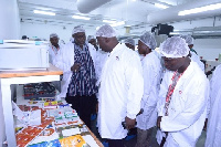 • Mr. Baiden (2nd right), showing Dr. Spio-Garbrah (3rd from right), some of the company's products