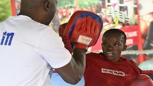 Kenyan national boxing team head coach Benjamin Musa, trains Kenya's boxer Christine Ongare