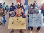 Some NPP members holding a placard with the inscription 'Party structures must work'