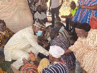 Alhaji Umar Farouk Aliu Mahama exchanging pleasantries with some chiefs and people of Yendi
