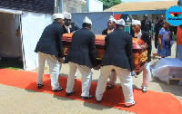 Pallbearers carry the remains of Wili Roi