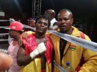Winner: Ayi poses with one of his cornermen