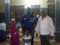 The little with his mother and police personnel