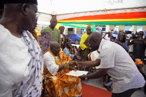 Togbi Sri lll receiving his letter of appointment at a colorful ceremony in Anlo