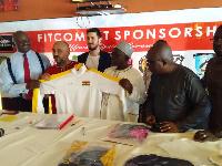 Alhaji Grusah, Kudjoe Finaoo, Frank Nelson and reps from Fitcom displaying the jersey
