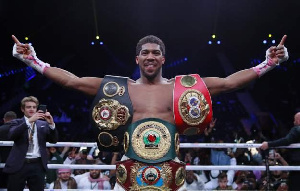 Anthony Joshua with his tittle