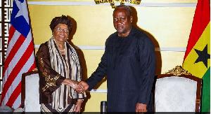 President John Mahama in an handshake with President Ellen Johnson Sirleaf