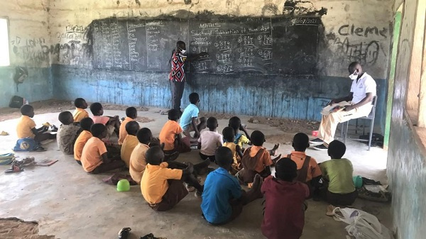 This how the pupils sit on the floor in other to have studies in the Saabisi Primary School