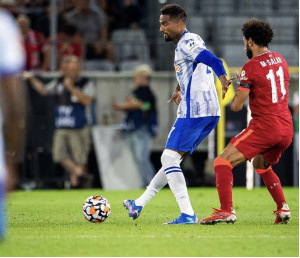 Kevin Prince Boateng wards off Salah during the game