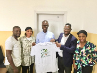 Members of BFC presenting a shirt to former youth and Sports Minister Honorable Dr. Mustapha Ahmed