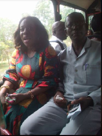 Catherine Abelema Afeku and Nsien SHS Headmaster Aboagye Mochiah seating in the bus she donated