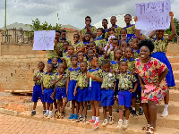 The teacher, Madina Adumtwumwa Asare with some of the students