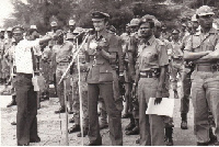 Former President Rawlings with by some soldiers during the revolution