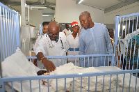 Vice President Amissah-Arthur being taken round the Children's ward by officials of the hospital.