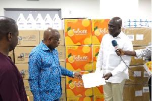 Chairman of Tobinco Group, Samuel Nana AmoTobbin I, presenting the items to the Minister of Health