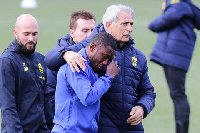 Waris being consoled by his manager,  Vahid Halilhodzic