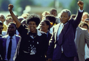 ANC leader Nelson Mandela and wife Winnie raising fists upon his release from Victor Verster prison