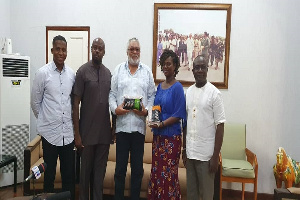 Former President, Jerry John Rawlings with some Rice Value Chain Actors