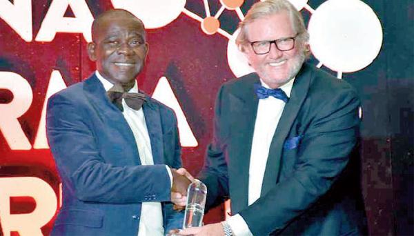 MD of ECPL, Ebenezer Bediako Amoafo-Hene receiving the award for Best Customer Service