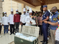 The Chefs' Association of Ghana presenting 2,000 packs of meals to the frontline staff and security