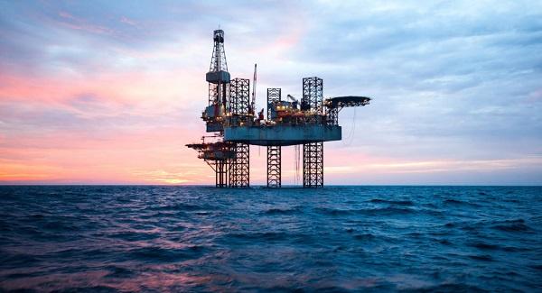 Oil rises as International Energy Agency boosts global demand forecast