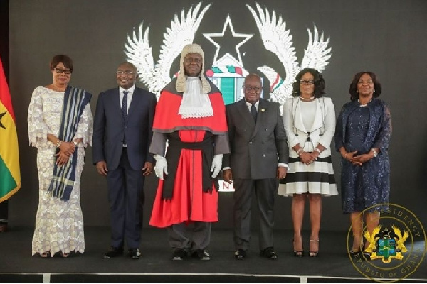 The Chief Justice flanked by the president, vice president, his predecessors and Attorney General