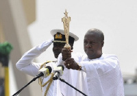 Former President John Dramani Mahama holding the State Sword during his swearing in ceremony
