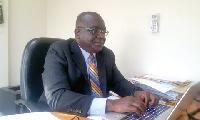 Managing Director of Adehyeman Savings and Loans, Mr Joe Emmim