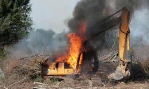 A photo of burnt excavators