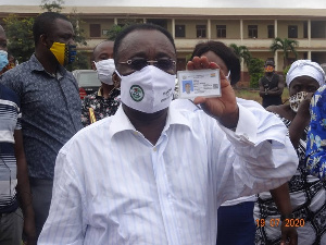 Minister for Food and Agriculture, Dr. Owusu Afriyie Akoto showing his voters ID card