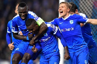 Joseph Aidoo caught by teammates in celebration after scoring