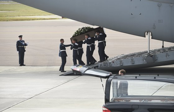 The coffin of Stephen Mellor is repatriated with other victims of the attack