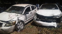 Some vehicles damaged by a police vehicle