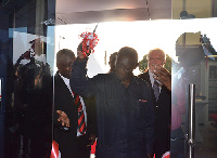 Ex-President Kufuor cutting the tape of the new bank