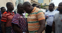 File photo: Nii Noi Nortey in NPP colours speaking to a supporter after he lost.