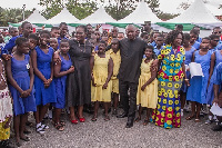 President John Dramani Mahama with Nana Oye Lithur and some students
