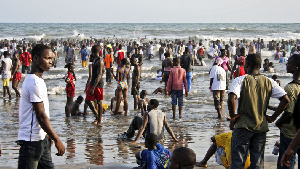 People enjoying themselves at the beach